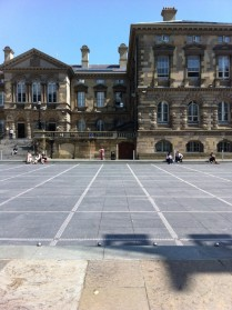 Custom House Sq business people acting as audience for pre-teen skateboarders