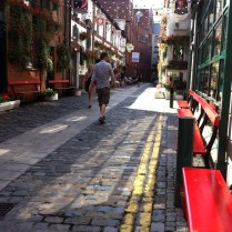 Sunny breaks at the Duke of Wellington Pub's Red themed cobble street